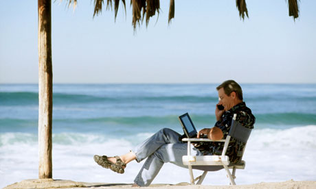 Using mobile Phone and Laptop on Tropical Beach