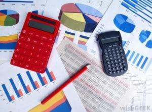 two-calculators-a-pencil-and-charts-300x222.jpg